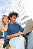 Young people in front of college building Stock Photography