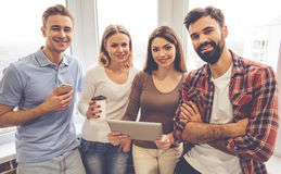 Young people with gadgets Stock Photos