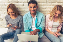 Young people with gadgets stock image