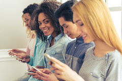 Young people with gadgets Royalty Free Stock Image