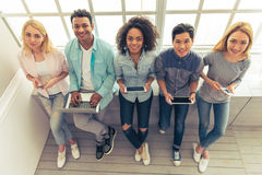 Young people with gadgets royalty free stock photo
