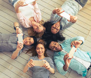 Young people with gadgets Royalty Free Stock Photography