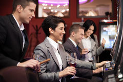 Young people gambling on slot machines Royalty Free Stock Photo