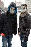 Young people in gas masks. Russia. Saratov. December 18, 2009. Youth movement New people held a protest against the legalization of smoking mixtures JWH-018 Royalty Free Stock Image