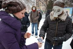 Young people in gas masks. Russia. Saratov. December 18, 2009. Youth movement New people held a protest against the legalization of smoking mixtures JWH-018 Stock Photos