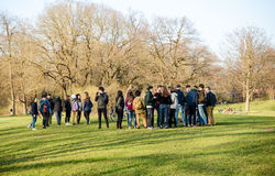 Young people gather in the Englischer Garten. In Munich after school royalty free stock photography