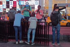Young people gather in Times Square. NEW YORK CITY, USA, September 10, 2017 : Young people gather in Times Square. Times Square is a major commercial stock photos