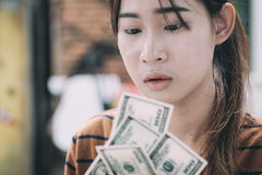 Young people give money on hand. Royalty Free Stock Photo