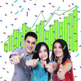 Young people giving thumbs up. Group of young people giving thumbs up on growing graph Stock Image