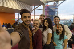 Young People Group In Airport Lounge Waiting Departure Happy Smile Mix Race Friends Taking Selfie Photo Royalty Free Stock Image