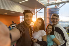 Young People Group In Airport Lounge Waiting Departure Happy Smile Mix Race Friends Taking Selfie Photo Royalty Free Stock Images