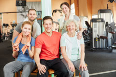 Young people group as a team with senior woman. Happy oung people group as a team with senior women at the gym Royalty Free Stock Images