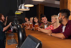 Young People Group In Bar, Barman Friends Sitting At Wooden Counter Pub, Drink Beer Royalty Free Stock Images