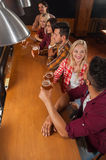 Young People Group In Bar, Friends Sitting At Wooden Counter Pub, Drink Beer. Communication Party Celebration Stock Images