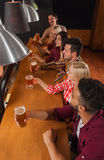 Young People Group In Bar, Friends Sitting At Wooden Counter Pub, Drink Beer. Communication Party Celebration Stock Photography
