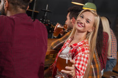 Young People Group In Bar, Girl Sitting At Wooden Counter Pub, Drink Beer. Party Celebration Royalty Free Stock Images
