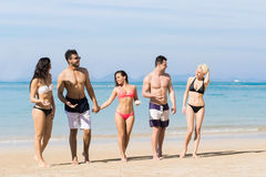Young People Group On Beach Summer Vacation, Happy Smiling Friends Walking Seaside Sea Ocean stock images