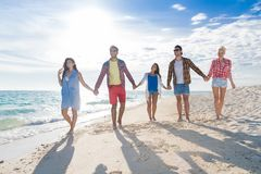 Young People Group On Beach Summer Vacation, Happy Smiling Friends Walking Seaside Royalty Free Stock Photos