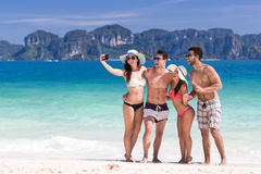 Young People Group On Beach Summer Vacation, Two Couple Happy Smiling Friends Taking Selfie Photo. Sea Ocean Holiday Travel stock images