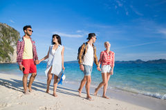Young People Group On Beach Summer Vacation, Two Couple Happy Smiling Friends Walking Seaside. Sea Ocean Holiday Travel royalty free stock photography