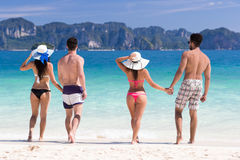 Young People Group On Beach Summer Vacation, Two Couple Holding Hands Friends Walking Seaside. Sea Ocean Holiday Travel stock images