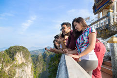 Young People Group In Mountain Using Cell Smart Phone Chatting Online Friends Asian Holiday Summer Stock Photos