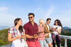 Young People Group In Mountain Using Cell Smart Phone Chatting Online Friends Asian Holiday Summer. Vacation Travel royalty free stock image