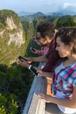 Young People Group In Mountain Using Cell Smart Phone Chatting Online Friends Asian Holiday Summer Royalty Free Stock Image