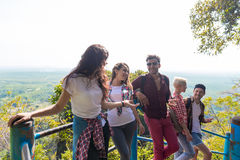 Young People Group Mountain View Point Happy Smiling Friends Talking Asian Holiday Summer. Vacation Travel Stock Images