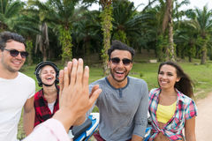Young People Group Sitting Motorbike, Young Man And Woman Travel On Bike On Tropical Forest Road Royalty Free Stock Photography