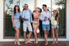 Young People Group On Terrace Tropical Hotel, Friends Using Cell Smart Phone Tropic Holiday Vacation Royalty Free Stock Photography
