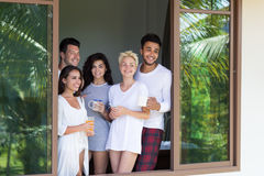 Young People Group On Terrace Tropical Hotel, Morning Friends Enjoy View Tropic Holiday Vacation Royalty Free Stock Photography