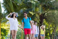 Young People Group Tropical Park Palm Trees Friends Walking Speaking Holiday Summer Vacation. Ocean Travel Royalty Free Stock Photo