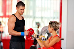 Young people in the gym Royalty Free Stock Images