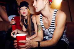 Young People Hanging Out in Club Lounge Royalty Free Stock Images