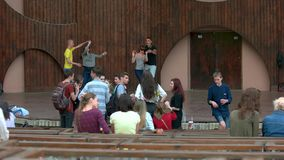 Young people hanging out on outdoor park stage. stock video