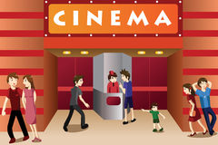 Young people hanging out outside a movie theater Royalty Free Stock Images