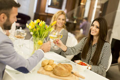 Young people have dinner and toasting white wine Royalty Free Stock Photo