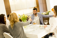 Young people have dinner and toasting white wine Stock Image