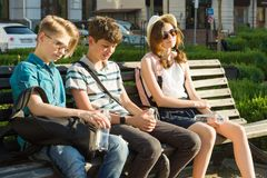 Young people have fun in the city, group of happy teenagers are talking, laughing, walking enjoying day. stock photos
