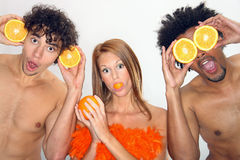 Young people have fun with oranges. Young people having fun with oranges Stock Image