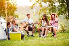 Young people have a good time in camp in nature Stock Images