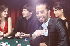 Young people have a good time in casino Stock Photo