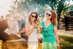 Millennials having a barbecue party, portrait of girls smiling and laughing stock image