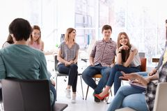 Young people having business training. In office royalty free stock image