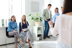Young people having business training. In office stock photos