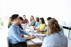 Young people having business training. In office stock photography