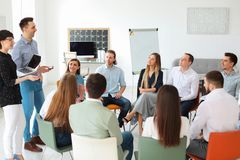 Young people having business training. In office royalty free stock photos