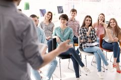 Young people having business training. In office royalty free stock photo