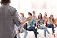Young people having business training. In office stock images